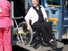 Woman with wheelchair and adapted van
