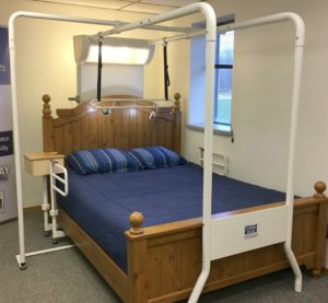 Photo of the Friendly Bed device consisting of bars surrounding a bed.