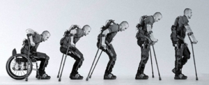 Series of pictures from man sitting in wheelchair to gradually standing in exoskeleton brace.