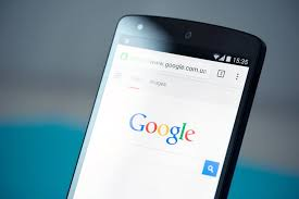 close up of Android phone with Google homepage on screen.