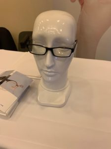 Close up of head mannequin with glasses on.