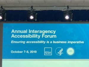 """Large screen with words """"Annual Interagency Accessibility Forum"""""""