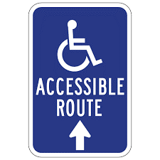 """Blue sign with write writing """"Accessible Route"""" with arrow"""