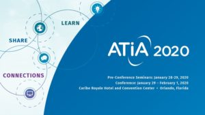 """Blue and white ATIA 2020 logo on screen with words 'share, learn, connections"""" and dates January  28 - February 1"""