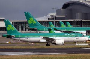 Airplanes at gates at airport.