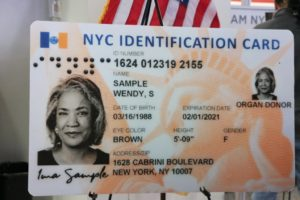 Close up of NYC Identification Card.  It has a picture of a women with Braille on top of picture.