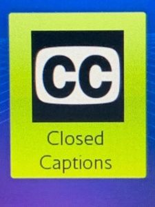 Close up of blue and green logo of closed captions